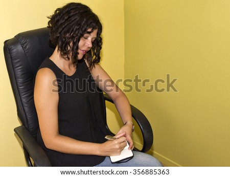Businesswoman writing on a note book - stock photo