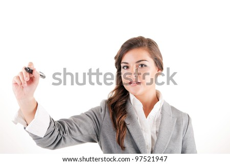 Businesswoman writing or drawing with pen on copy space - stock photo