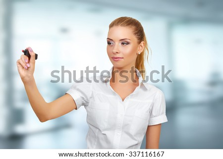 Businesswoman writing or drawing with pen on copy space / whiteboard. Casual beautiful young mixed race. Bright with backlight - stock photo