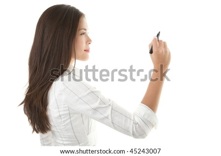 Businesswoman writing or drawing with pen on copy space / whiteboard. Casual beautiful young mixed race chinese / caucasian business woman isolated on seamless white background. Bright with backlight - stock photo