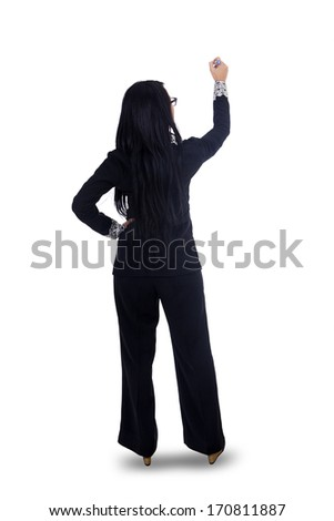 Businesswoman writing something with pen on whiteboard - stock photo