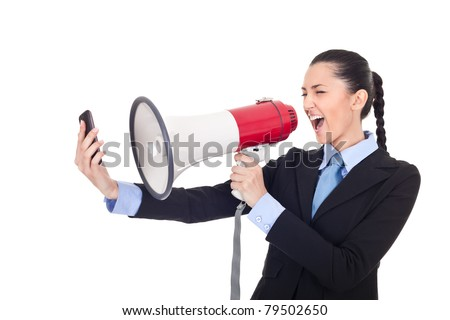 businesswoman yelling on phone through megaphone over white background - stock photo