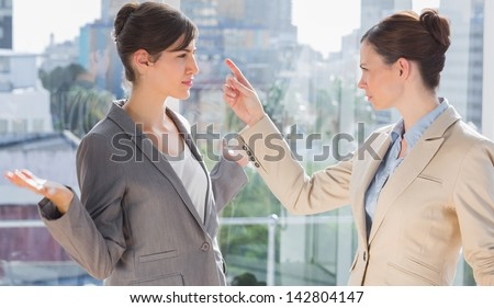 Businesswomen fighting in the office - stock photo