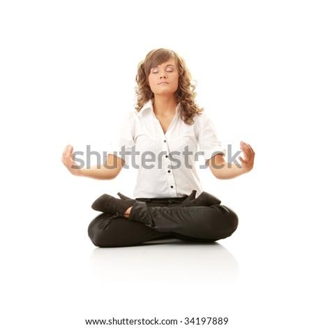 Businesswomen meditating in lotus position isolated on white - stock photo
