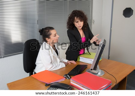 Businesswomen working at office - stock photo