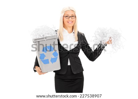 Busineswoman holding a recycle bin and bunch of shredded paper isolated on white background - stock photo