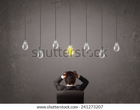 Businness guy in front of bright idea light bulbs concept - stock photo