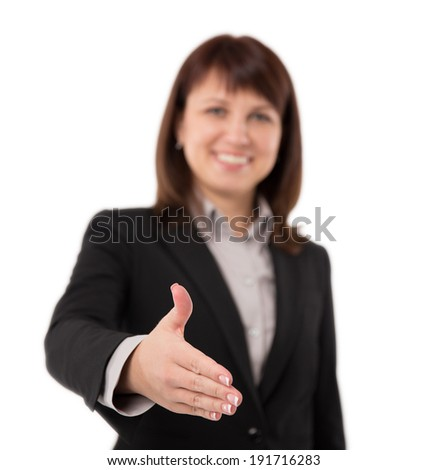 Busnesswoman going to shake your hand. Shallow depth of field, focus on fingers. - stock photo