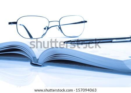 Bussines concept, callendar book, pen and glasses - stock photo