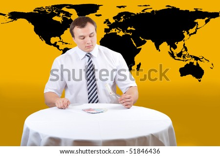 Bussines man eat euro on lunch, map of world as background - stock photo