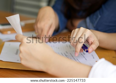 Bussines Women filling a Paperwork for agreement - stock photo