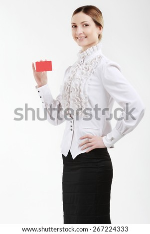 Bussinesswoman in a white blouse with a red plastic card - stock photo