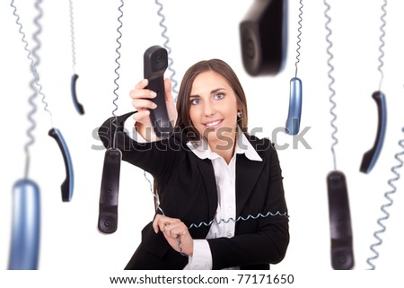busy and clumsy secretary working with phone, isolated on background - stock photo