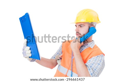 Busy builder, engineer or construction worker using phone on white copy space and  blank text area - stock photo