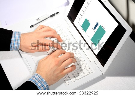 Busy business man doing some computer work - stock photo