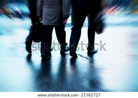 Busy business people walking. Motion blurred - stock photo