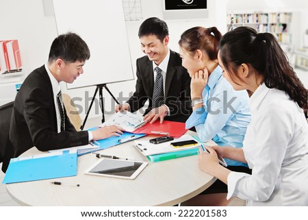 busy business people working digital tablet and laptop - stock photo