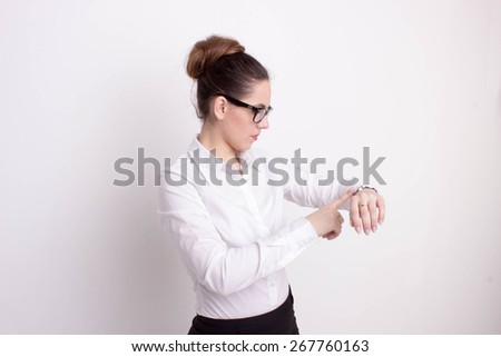 Busy business woman checking the time - stock photo