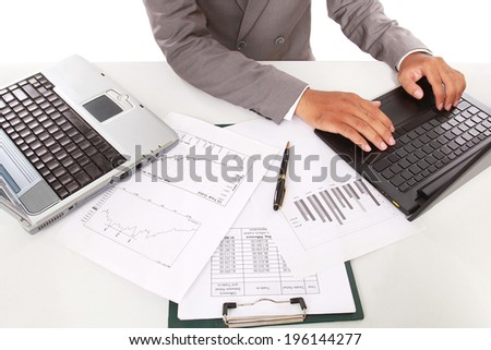 Busy businessman in office working on his laptop, isolated on white background - stock photo