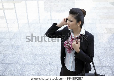 Busy Businesswoman lost direction - stock photo