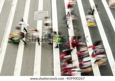 Busy city people on zebra crossing street - stock photo
