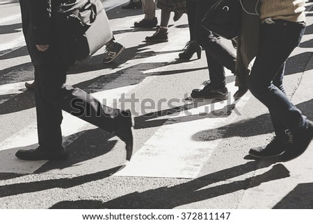 Busy city people on zebra crossing street,vintage filter. - stock photo