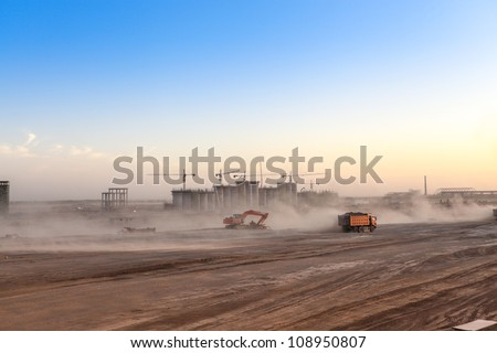 busy construction site at dusk,the dust was blowing - stock photo
