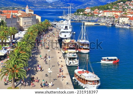 Busy harbor with tourist boats near old town of Trogir, Croatia - stock photo