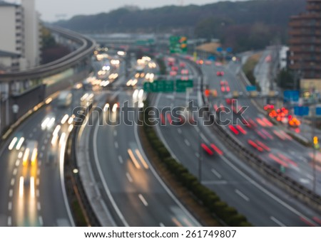 Busy highway at dusk - blurred background - stock photo