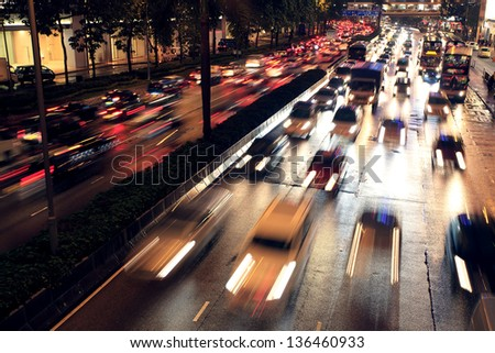 Busy highway at night - stock photo