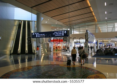 Busy international airport in US - stock photo