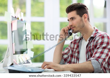 Busy man working on computer  - stock photo