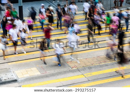 Busy pedestrian crossing in Hong Kong  - stock photo