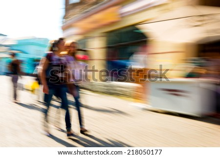 Busy people on the streets of the city  - stock photo
