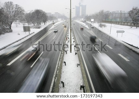 Busy road in winter - stock photo