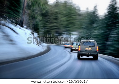 Busy road in winter evening on a mountain region - stock photo