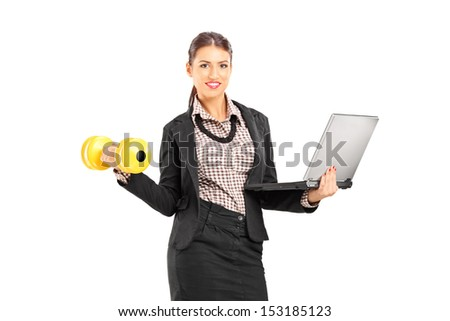 Busy smiling businesswoman holding a laptop and lifting a dumbbell isolated on white background - stock photo