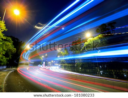 Busy traffic on road at night - stock photo