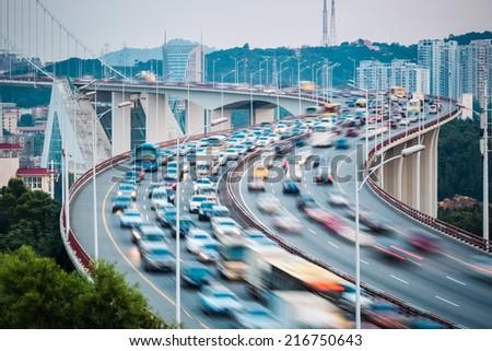 busy traffic stream with approach bridge graceful curve shape closeup  - stock photo