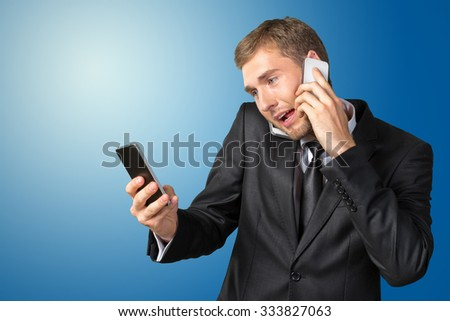 Busy young businessman talking the phone - stock photo