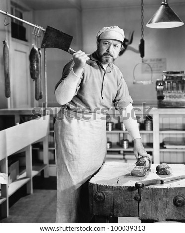 Butcher chopping meat with cleaver - stock photo