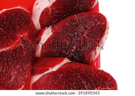 butchery : fresh raw beef lamb big fillet mignon ready to cooking on red tray isolated over white background - stock photo