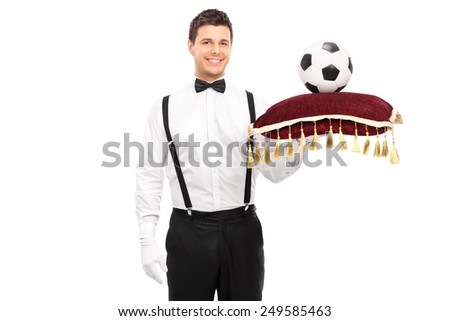 Butler holding a red pillow with football on it isolated on white background - stock photo