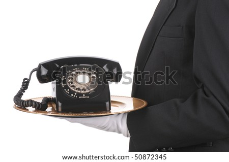 Butler Holding an Old Rotary Telephone on a tray  isolated on white side view of person torso only - stock photo