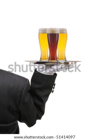 Butler in Tuxedo seen from behind with three beer glasses on serving tray held at shoulder height vertical format over white - stock photo