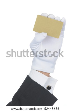 Butler's gloved hand holding up a blank gold credit card isolated over white. Hand and arm only in vertical format. - stock photo