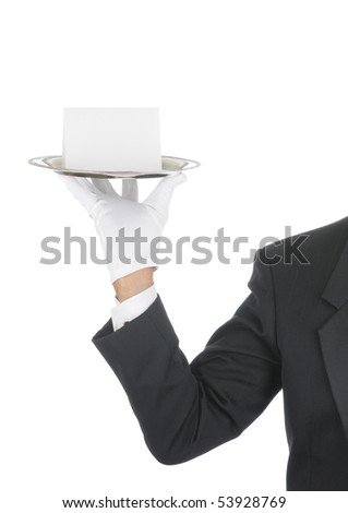 Butler wearing tuxedo and formal gloves holding a Blank Card on a silver tray. Shoulder hand and arm only isolated on white vertical composition. - stock photo