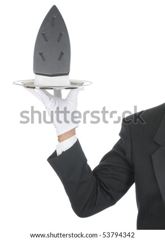 Butler wearing tuxedo and formal gloves holding an iron on a silver tray. Shoulder hand and arm only isolated on white vertical composition. - stock photo