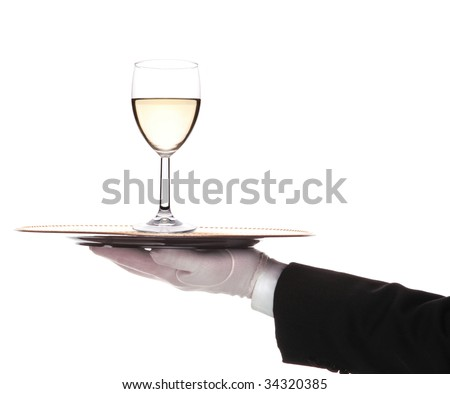 Butler with White Wine Glass and tray on outstretched arm - stock photo