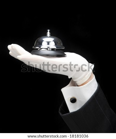 Butlers outstretched hand and arm with service bell. - stock photo